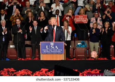 HERSHEY, PA - DECEMBER 15, 2016: President-Elect Donald Trump gestures by pointing as he delivers a speech to a large crowd at a Thank You rally held at the Giant Center.
