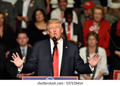 HERSHEY, PA - DECEMBER 15, 2016: President-Elect Donald Trump gestures with both hands during a speech to a large crowd at a Thank You tour stop held at the Giant Center.