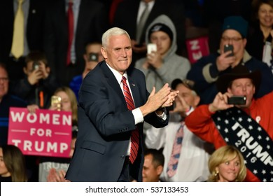 HERSHEY, PA - DECEMBER 15, 2016: Vice President-Elect Mike Pence applauds as he comes on stage to deliver a speech to a large crowd at a Thank You rally held at the Giant Center.