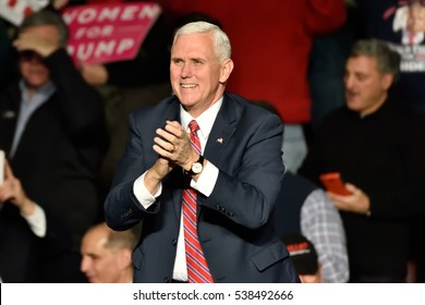 HERSHEY, PA - DECEMBER 15, 2016: Vice President-Elect Mike Pence applauds as he arrives on stage to deliver a speech to a large crowd at a Thank You rally held at the Giant Center.