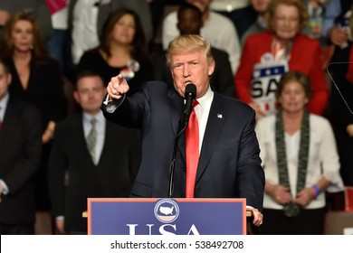 HERSHEY, PA - DECEMBER 15, 2016: President-Elect Donald Trump makes a pointing gesture toward the media during a speech to a large crowd at a Thank You tour rally held at the Giant Center.