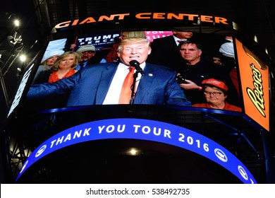 "HERSHEY, PA - DECEMBER 15, 2016: President-Elect Donald Trump as seen on the large center hung HD scoreboard during a ""Thank You"" Tour rally at the Giant Center. This Jumbotron is made by Daktronics."