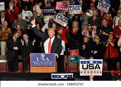 HERSHEY, PA - DECEMBER 15, 2016: President-Elect Donald Trump gives a thumbs up gesture during a speech to a large crowd at a Thank You tour rally held at the Giant Center.