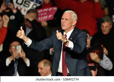 HERSHEY, PA - DECEMBER 15, 2016: Vice President-Elect Mike Pence gives a thumbs up gesture as he arrives on stage to deliver a speech to a large crowd at a Thank You rally held at the Giant Center.