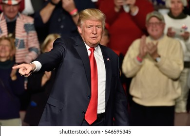 "HERSHEY, PA - DECEMBER 15, 2016: President-Elect Donald Trump points right toward the crowd as he concludes his speech at a ""Thank You Tour"" rally held at the Giant Center."