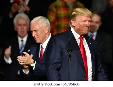 "HERSHEY, PA - DECEMBER 15, 2016: President-Elect Donald Trump and Vice President-Elect Mike Pence reposition on stage at a ""Thank You"" Tour rally held at the Giant Center."