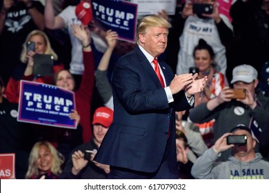 """HERSHEY, PA - DECEMBER 15, 2016: President Trump walks on stage as he prepares to deliver his speech at a """"Thank You"""" Tour rally held at the Giant Center."""