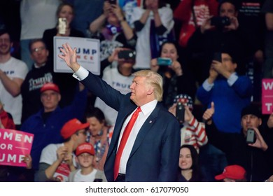 "HERSHEY, PA - DECEMBER 15, 2016: President Trump waves to the crowd during his speech at a ""Thank You"" Tour rally held at the Giant Center."