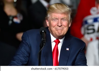 "HERSHEY, PA - DECEMBER 15, 2016: President Trump ""Cheshire cat"" smile during his speech at a ""Thank You"" Tour rally held at the Giant Center."
