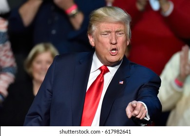 "HERSHEY, PA - DECEMBER 15, 2016: President Donald Trump dynamic pointing toward the crowd at a ""Thank You Tour"" rally held at the Giant Center."