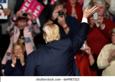 HERSHEY, PA - DECEMBER 15, 2016: Donald Trump President of the United States waves to the crowd with his back turned to the main audience during a campaign rally at the Giant Center.