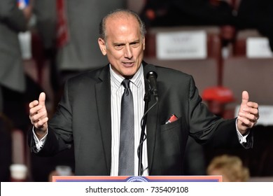 "HERSHEY, PA - DECEMBER 15, 2016: Congressman Tom Marino gestures during a speech at a campaign rally for President Elect Donald Trump at a ""Thank You"" tour rally."