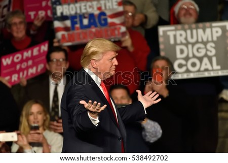 HERSHEY, PA - DECEMBER 15, 2016: President-Elect Donald Trump opens his arms wide as he approaches Vice President-Elect Mike Pence on stage at a Thank You rally held at the Giant Center.