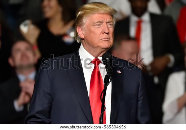 "HERSHEY, PA - DECEMBER 15, 2016: President-Elect Donald Trump makes a proud gesture during his speech at a ""Thank You"" Tour rally held at the Giant Center."