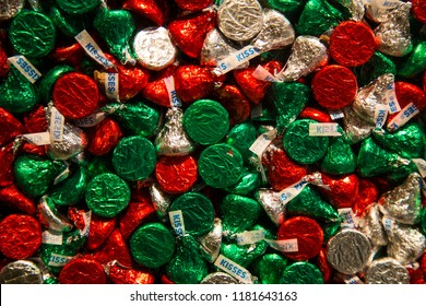 Hershey, PA, USA – December 10, 2015: Foil wrapped Hershey s Kisses in Christmas colors on display in ChocolateWorld.