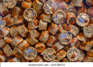 Hershey, PA, USA - December 11, 2018:  Closeup of foil wrapped Reese's Miniature Peanut Butter Cups candy.