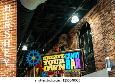 Hershey, PA, USA - December 11, 2018:  a Make Your Own Candy Bar sign in the Chocolate World main lobby.