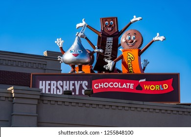 Hershey, PA, USA - December 11, 2018:  Hershey Candy Characters waving from a roof at the entrance to Chocolate World.