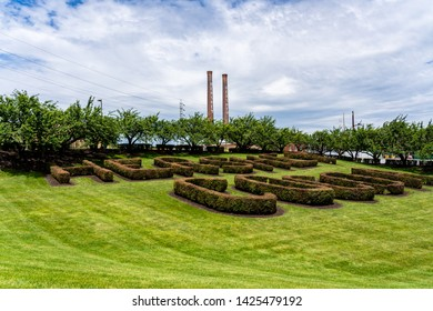 Hershey, PA, USA - June 15, 2019: The Hershey Candy Factory with its iconic smokestacks and Hershey Cocoa bush design in downtown Hershey.