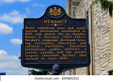 Hershey, PA, USA - May 21, 2018: An historical marker sign stands in front of the Hershey Chocolate Factory.