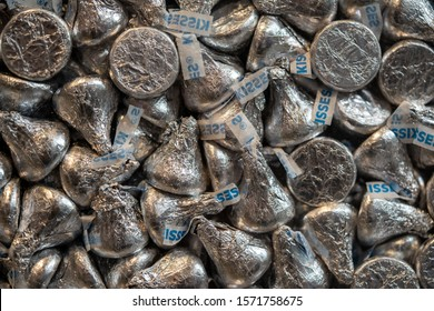 Hershey, PA USA - November 26, 2019:  Silver foil wrapped Hershey Milk Chocolate Kisses on display in Chocolate World.