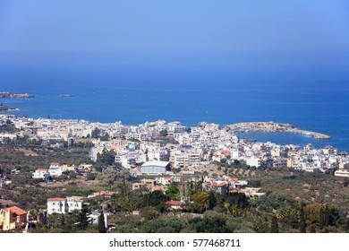 HERSONISSOS, CRETE - SEPTEMBER 18, 2016 - Elevated view of the town, harbour and sea, Hersonissos, Crete, Greece, Europe, September 18, 2016.