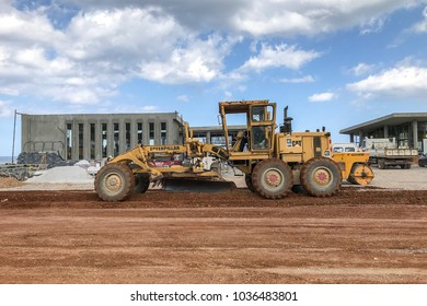 Hersonissos, Greece. February 11, 2018: View on the road grader working on the new road construction site