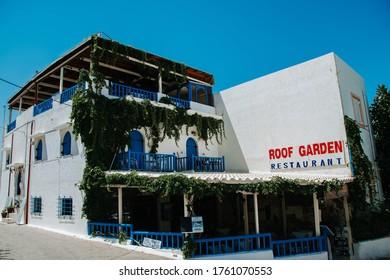 Hersonissos,Crete/Greece - 07.03.2018: Greek restaurant with green plants on walls and blue balcony.