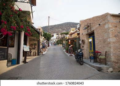Hersonissos,Crete/Greece - 07.20.2018: Empty alley with many restaurants, waiting for tourists to come to dinner.