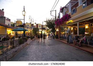 Hersonissos,Crete/Greece - 07.20.2018: A group of girls walking in old town Hersonissos.