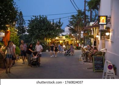 Hersonissos,Crete/Greece - 07.20.2018: People enjoying vacation evening in Crete island. Restaurants area in old town of Hersonissos