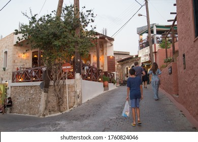 Hersonissos,Crete/Greece - 07.20.2018: People relaxing at the restarants and eating dinner in picturesque town in Crete