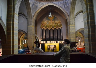 Hertogenbosch/ Netherlands - 29.10.2018:  A man is looking at the copy of a famous Jheronimus Bosch's painting in A Dutch Bosch Art Center