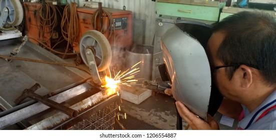 He's working on welding and steel work.
