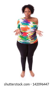 Hesitating young fatty black woman looking up, isolated on white background - African people
