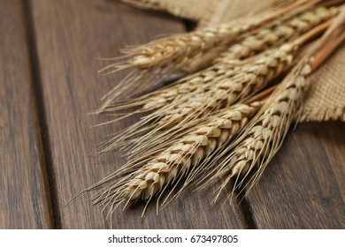 hessian cloth and wheat on wooden table
