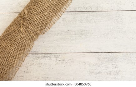 Hessian fabric roll with space on wood background