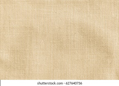 Hessian sackcloth burlap texture background in beige cream brown color
