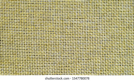 Hessian sackcloth burlap woven texture background, Cotton woven fabric close up with flecks of varying colors of beige and brown, with copy space for text decoration.