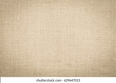 Hessian sackcloth burlap woven texture background in yellow beige cream sepia brown color