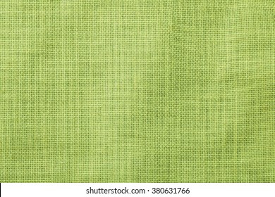 Hessian sackcloth woven texture pattern background in yellow green