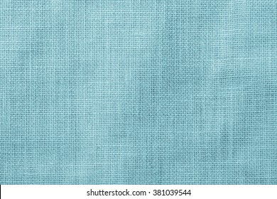 Hessian sackcloth woven texture pattern background in light cyan green blue