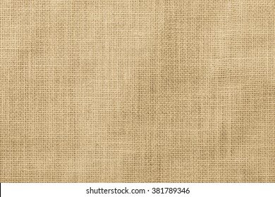 Hessian sackcloth woven texture pattern background in light cream yellow beige color