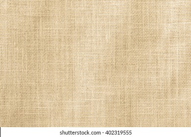 Hessian sackcloth woven texture pattern background in yellow beige cream brown color