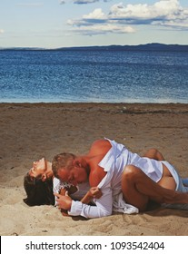 Heterosexual Couple kissing on the beach. Couple in love. Fashion photo. Adult. Having sex. Model. Passionate concept. Hot girl. Sea beach. Erotic. Beauty. Sensuality. Lifestyle. Dreaming. Life.