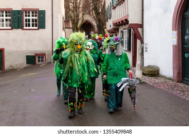 Heuberg, Basel, Switzerland - March 11th, 2019. Close-up of a carnival marching group in green costumes