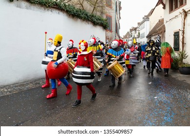 Heuberg, Basel, Switzerland - March 11th, 2019. Close-up of a carnival marching group in colorful costumes