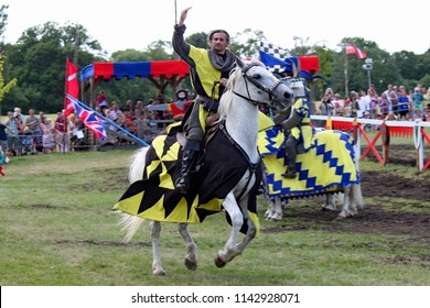 Hever,Kent/UK 07-28-13 A beautiful action shot from the jousting tournament as a knight celebrates his victory on his trusty steed