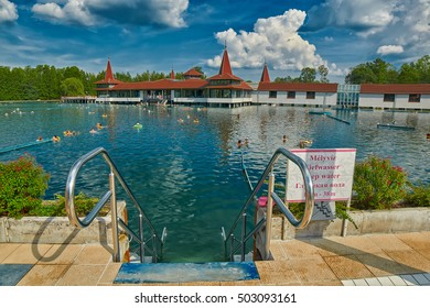 "HEVIZ, HUNGARY - 15 August 2016: Entry to Heviz Themal Water Lake Resort with sign saying ""Deep Water"""