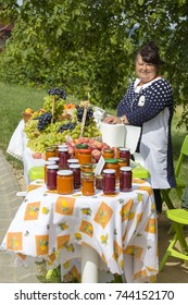 HEVIZ, HUNGARY - AUGUST 12, 2017 : Unknown woman sells fruit and preserves in the food market in Heviz, Hungary. The city famous for its thermal lake of Heviz, a unique creation of nature.